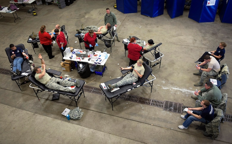 Airmen with the 182nd Airlift Wing, Illinois Air National Guard, donate blood in Peoria, Ill., Feb. 5, 2017. Peoria's Airmen exceeded the unit's goal by 14% and provided 57 pints of blood during a national emergency need appeal by the American Red Cross. (U.S. Air National Guard photo by Tech. Sgt. Lealan Buehrer)