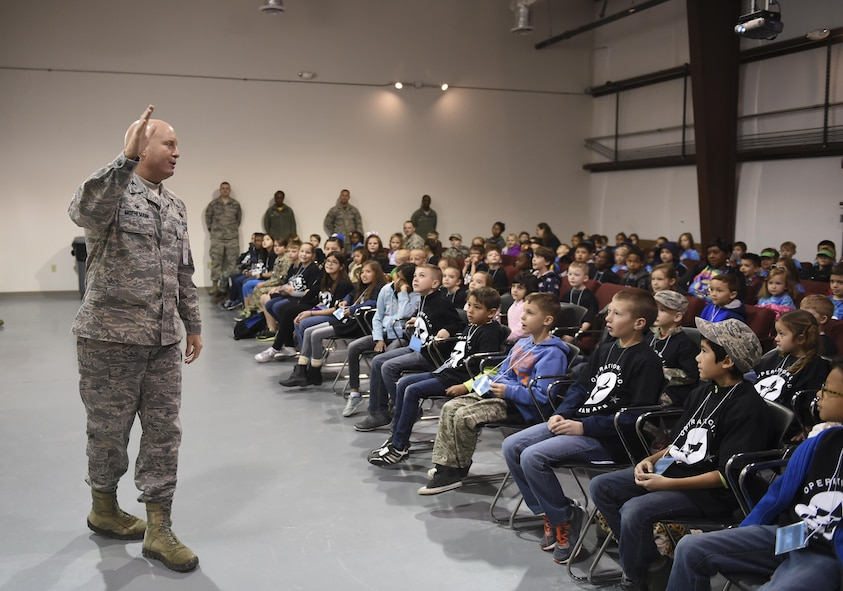 Colonel Joseph Moehlmann, the 635th Materiel Maintenance Group commander, briefs a group of children during Operation Kids Investigating Deployment at Holloman Air Force Base, N.M., Feb. 3, 2017. Operation KID is an annual event allowing children of military members to acquire a better understanding of what their parent goes through prior to a deployment. Military children were given a walk around the Basic Expeditionary Airfield Resources compound to see a mock deployment site, a mission brief, painted their faces, tried on Mission Oriented Protective Posture gear, and learn about different equipment including the opportunity to see a robot demonstration from Holloman's Explosive Ordnance Disposal unit. (U.S. Air Force photo by Staff Sgt. Stacy Jonsgaard)