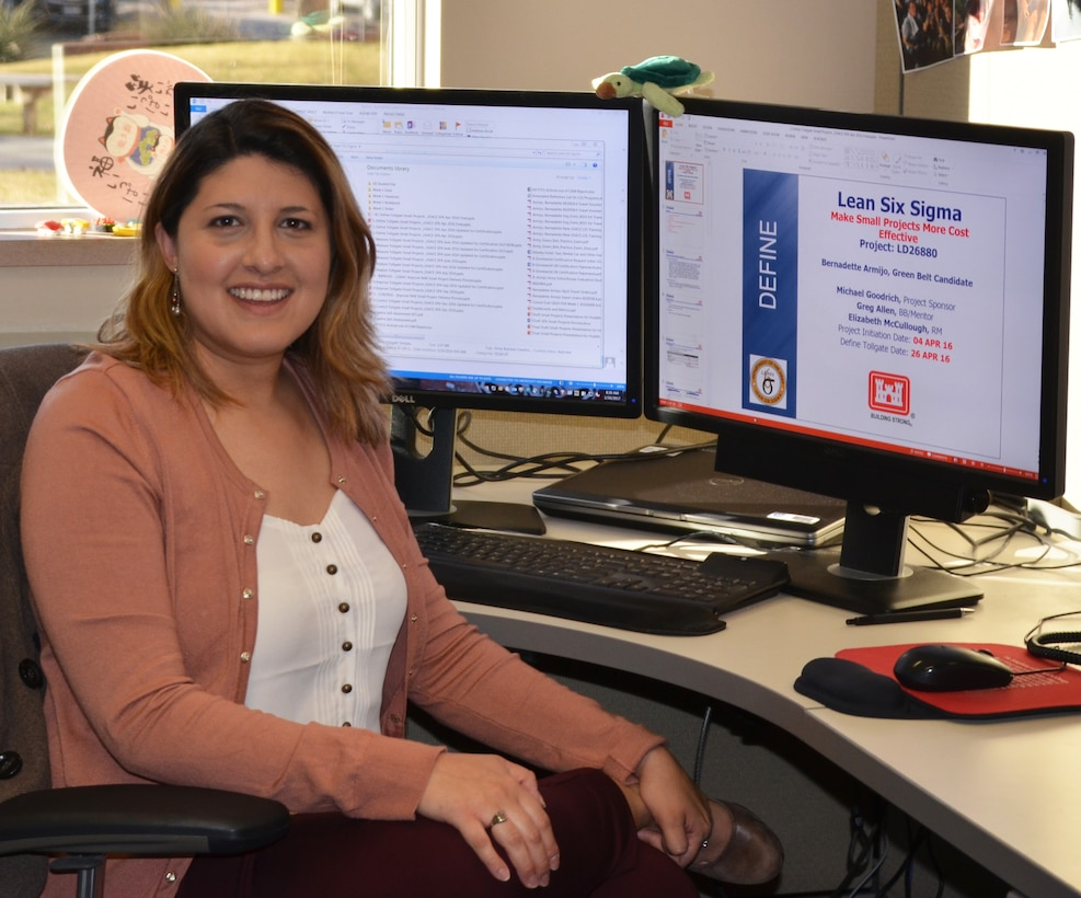 ALBUQUERQUE, N.M. -- Project manager Bernadette Gronewold, the District's first Lean Six Sigma green belt certified employee, sits at her desk, Jan. 30, 2017. The project she completed as part of her certification is on the screen behind her.