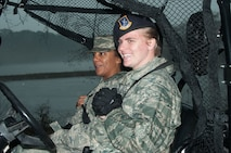 "Chief Master Sgt. Erica Shipp, 42nd Air Base Wing command chief, and Staff Sgt. Brooke Verbrigghe, 42nd Security Forces Squadron supply noncommissioned officer, ride in an all terrain vehicle on Maxwell Air Force Base, Ala., Feb. 07, 2017.  The tour is the first of a bi-monthly ""Crusader Experience"" that 42nd Air Base Wing commander Col. Eric Shafa and Chief Shipp will participate in over the next year.  The intent of the program is to allow wing leadership to spend an hour or two with each wing organization, get a closer look at what they do, and meet the Airmen and civilians working hard to carry out their missions every day(US Air Force photo by Bud Hancock)"