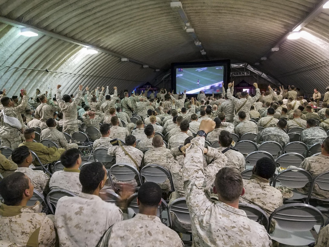 Marines and sailors cheer in response to a big play during the Palm Springs Bob Hope USO hosted showing of Super Bowl LI at the dining facility at Camp Wilson aboard Marine Corps Air Ground Combat Center, Twentynine Palms, Calif., Feb. 5, 2017. (U.S. Marine Corps photo by Cpl. Levi Schultz)