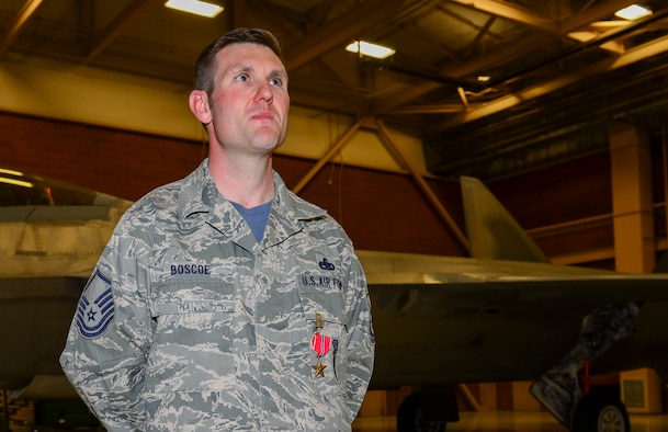 Master Sgt. Christopher Boscoe, 57th Aircraft Maintenance Squadron F-22 weapons section chief, poses for a photo after being awarded the Bronze Star Medal at Nellis Air Force Base, Nevada, Feb. 3, 2017. He was awarded the medal for his actions as a weapon system advisor in support of Operation Freedom Sentinel at Forward Operating Base Oqab, Kabul, Afghanistan from Oct. 4, 2015 to Sept. 28, 2016.