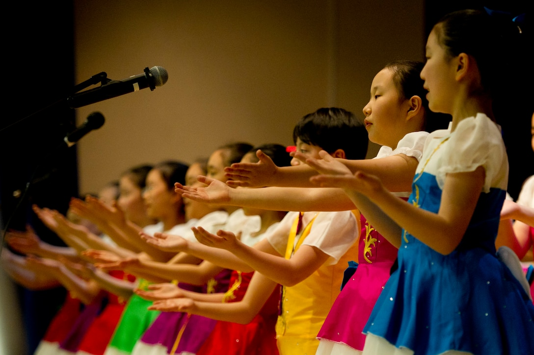 The Far East Broadcasting Company Children's Choir sings to the audience at Osan's National Prayer Breakfast 2017 at Osan Air Base, Republic of Korea, Feb. 8, 2017. The children's choir, established in 1991, sang the U.S. and ROK national anthems along with a variety of other songs. (U.S. Air Force photo by Staff Sgt. Jonathan Steffen)