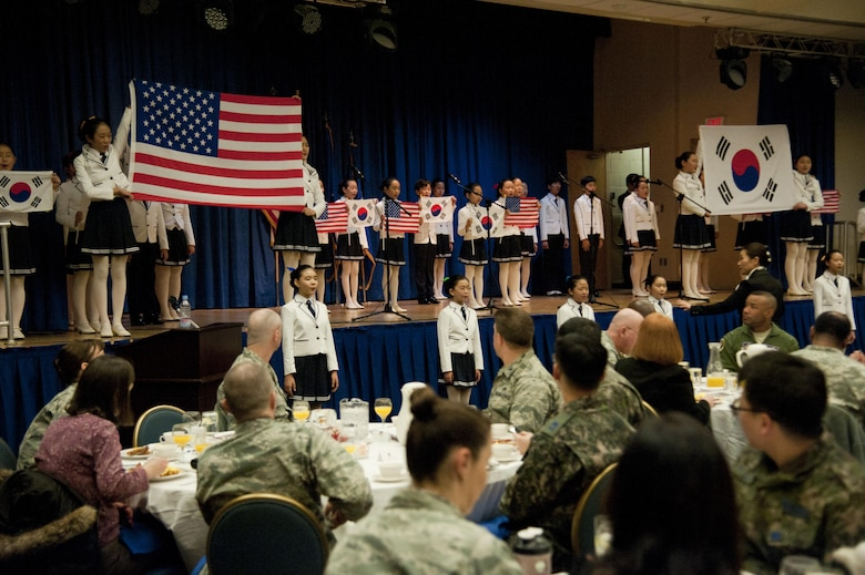 The Far East Broadcasting Company Children's Choir performs at the Osan National Prayer Breakfast 2017 at Osan Air Base, Republic of Korea, Feb. 8, 2017. The National Prayer Breakfast was established in 1953 by President Dwight D. Eisenhower in effort to unite U.S. leadership. (U.S. Air Force photo by Staff Sgt. Jonathan Steffen)