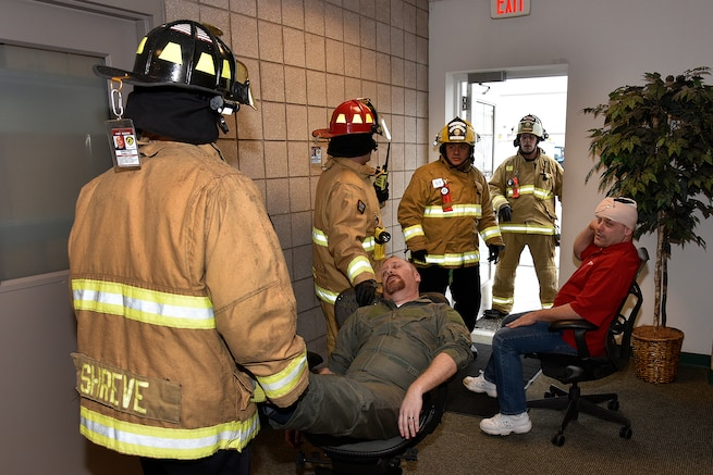 170207-Z-MI929-059 - Firefighters with the 127th Civil Engineer Squadron Fire Department evacuate casualties from a building at Selfridge Air National Guard Base, Mich., during an active shooter exercise on Feb. 7, 2017. The 127th Wing performs exercises like this one to prepare airmen and civilian employees to survive an incident on base or in their civilian lives. (Michigan Air National Guard photo by Terry L. Atwell/released)
