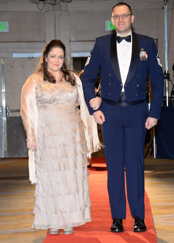 146th Airlift Wing's Master Sgt. Joshua Baker and his wife Kelly walk the red carpet at the 2017 Outstanding soldier/Airman of the Year Banquet. Baker took the prize in the state's First Sergeant category. (U.S. ANG photo by: Staff Sgt. Kim Ramirez)