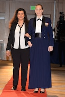 146th Airlift Wing's Master Sgt. Kelly Abbott and her fiancée Yohana walk the red carpet at the 2017 Annual Outstanding Soldier/Airman of the Year Banquet. (U.S. ANG photo by: Staff Sgt. Kim Ramirez)