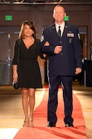 146th Airlift Wing's Tech. Sgt. Bryan Farmer and his fiancée Bay walk the red carpet at the 2017 Annual Outstanding Soldier/Airman of the Year Banquet. (U.S. ANG photo by: Staff Sgt. Kim Ramirez)