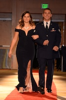146th Airlift Wing's Senior Airman Ryan Anzil walks the red carpet with his girlfriend at the 2017 Annual Outstanding Soldier/Airman of the Year Banquet. (U.S. ANG photo by: Staff Sgt. Kim Ramirez)