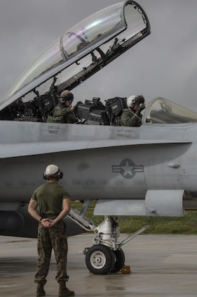 U.S. Marine Corps pilots with Marine All-Weather Fighter Attack Squadron (VMFA) – 225 board an F/A-18D prior to take off during exercise Cope North at Andersen Air Force Base, Guam, Feb. 9, 2017. The Marines loaded live air intercept missile – 120 advanced medium-range air-to-air missiles (AIM-120 AMRAAM) to F/A-18D Hornets to be fired at decoys down range. (U.S. Marine Corps photos by Cpl. Nathan Wicks)