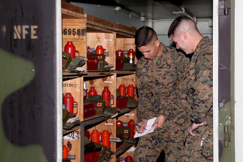 """Sgt. Ryan Tugas, left, and Sgt. Devon Bushey assess motor transport inventory for Marine Tactical Air Command Squadron 28 during an inspection aboard Marine Corps Air Station Cherry Point, N.C., Jan. 31, 2017. """"I am a better Marine because I was a boy scout,"""" said Tugas, a motor transport operator assigned to MTACS-28, Marine Air Control Group 28, 2nd Marine Aircraft Wing. Tugas attributes leadership traits learned as a former Boy Scout to his success in the Marine Corps. Bushey is a motor transport operator with MTACS-28, Marine Air Control Group 28, 2nd Marine Aircraft Wing. (U.S. Marine Corps photo by Cpl. Jason Jimenez/ Released)"""