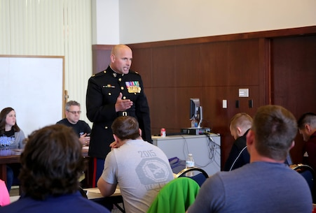 Major Ryan Cohen speaks with mentors and coaches ahead of the Women's Collegiate Wrestling Association Championship event in Oklahoma City. The Marines intend to show the wrestlers, coaches and mentors that their fighting spirit is much like our own. Cohen is the Commanding Officer for Recruiting Station Oklahoma City. The pre-tournament occurred on Feb. 9, and the tournament is scheduled for Feb. 10-11.