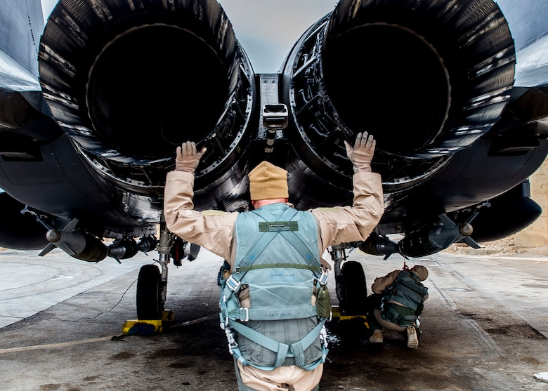 Col. David Brynteson, the 332nd Expeditionary Operations Group commander, checks the engines on an F-15E Strike Eagle, Jan. 27, 2016, in Southwest Asia. Brynteson was preparing to fly his last sortie in theater. (U.S. Air Force photo/Staff Sgt. Eboni Reams)