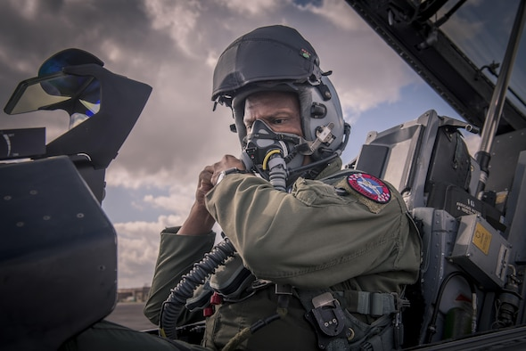 An F-16 Fighting Falcon pilot, assigned to Detachment 1, 138th Fighter Wing, dons his helmet in preparation of a barnstorming performance for reporters, Feb. 1, 2017, in Houston. (U.S. Air National Guard photo/Tech. Sgt. Drew A. Egnoske)