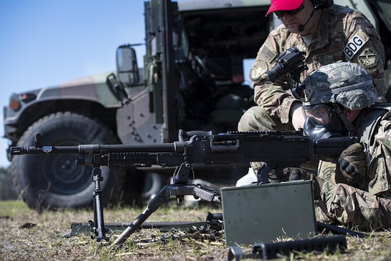 Airman 1st Class Jesse Kassed, a 822nd Base Defense Squadron fireteam member, fires an M240B machine gun at fixed targets down range Feb. 3, 2017, at Moody Air Force Base, Ga. A bipod holds the M240B as Kassed aims and fires 800 rounds at fixed targets while wearing a gas mask. (U.S. Air Force photo/Airman 1st Class Janiqua P. Robinson)