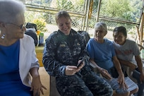 PUERTO BARRIOS, Guatemala  (Feb. 7, 2017) - Chief Musician Erin Horn, a native of Norwood, N.Y., attached to U.S. Fleet Forces (USFF) Band, Norfolk, Va., shares family photos with host nation residents during a visit to a community center for senior-citizens in support of Continuing Promise 2017's (CP-17) visit to Puerto Barrios, Guatemala. CP-17 is a U.S. Southern Command-sponsored and U.S. Naval Forces Southern Command/U.S. 4th Fleet-conducted deployment to conduct civil-military operations including humanitarian assistance, training engagements, and medical, dental, and veterinary support in an effort to show U.S. support and commitment to Central and South America. (U.S. Navy photo by Mass Communication Specialist 2nd Class Shamira Purifoy)