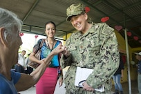 PUERTO BARRIOS, Guatemala (Feb. 7, 2017) - Lt. Cmdr. Amy Zaycek, assessments officer in charge for Continuing Promise 2017 (CP-17) and assigned to Capt. James A. Lovell Federal Health Care Center, North Chicago, Ill., speaks with a host nation resident during a visit to a community center for senior citizens in support of CP-17's visit to Puerto Barrios, Guatemala. CP-17 is a U.S. Southern Command-sponsored and U.S. Naval Forces Southern Command/U.S. 4th Fleet-conducted deployment to conduct civil-military operations including humanitarian assistance, training engagements, and medical, dental, and veterinary support in an effort to show U.S. support and commitment to Central and South America. (U.S. Navy photo by Mass Communication Specialist 2nd Class Shamira Purifoy)