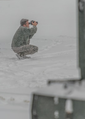 SSgt. Andrew Sinclair, a Broadcast Journalist films maintenance personnel at the 101st Air Refueling Wing, Bangor, Maine, Feb. 5, 2015.  The northeast is having a record breaking season of blizzards and snow accumulation and Airmen of the Maine Air National Guard perform outdoor duties in some of the harshest weather of the year.  (Air National Guard Photo by Master Sgt. Jon Duplain/Release)