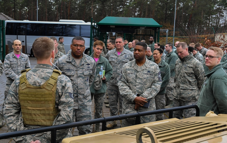 Lt. Gen. Richard M. Clark, 3rd Air Force commander, and Chief Master Sgt. Phillip Easton, U.S. Air Forces in Europe and Air Forces Africa command chief, receive a brief from Staff Sgt. McKenzie Lauber, 1st Combat Communications Squadron combat readiness instructor, during an immersion tour of the 435th Air Ground Operations Wing at Ramstein Air Base, Germany, Feb. 3, 2017. Clark and Easton toured squadrons within the wing's three local groups, ate lunch with several 435 AGOW Airmen, and spoke at a commander's call during the tour. (U.S. Air Force photo by Senior Airman Tryphena Mayhugh)