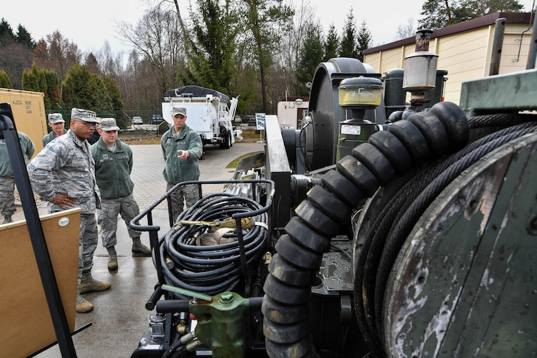 Lt. Gen. Richard M. Clark, 3rd Air Force commander, learns about equipment used by the 435th Construction and Training Squadron from Senior Airman Andrew Wiegand, 435 CTS aircraft arresting system maintenance technician, during an immersion tour of the 435th Air Ground Operations Wing at Ramstein Air Base, Germany, Feb. 3 2017. The tour featured displays from squadrons within the 4th Air Support Operations Group, 435th Air and Space Communications Group, and 435th Contingency Response Group. (U.S. Air Force photo by Senior Airman Tryphena Mayhugh)