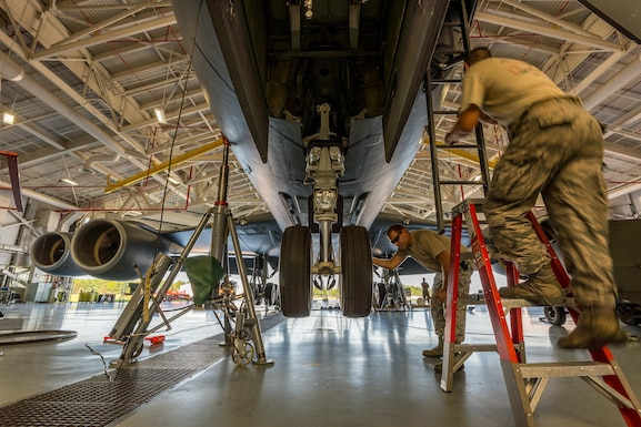 Members of the Maine Air National Guard 101st Air Refueling Maintenance Squadron inspect a jacked U.S. Air Force KC-135R Stratotanker Sept. 17, 2015. The maintainers raise the KC-135R to perform an operational check of the landing gear system to ensure its functioning properly after a sequence valve replacement. (Air National Guard Photo by Master Sgt. Jon Duplain/Released)