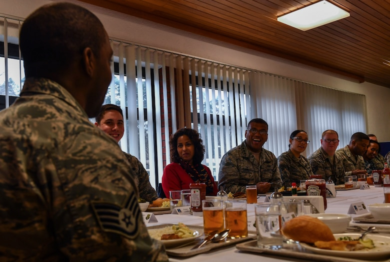 Lt. Gen. Richard M. Clark, 3rd Air Force commander, eats lunch with Airmen from the 435th Air Ground Operations Wing during an immersion tour at Ramstein Air Base, Germany, Feb. 3, 2017. The purpose of the tour was to provide a venue for Clark to witness the 435 AGOW's mission firsthand. (U.S. Air Force photo by Senior Airman Tryphena Mayhugh)