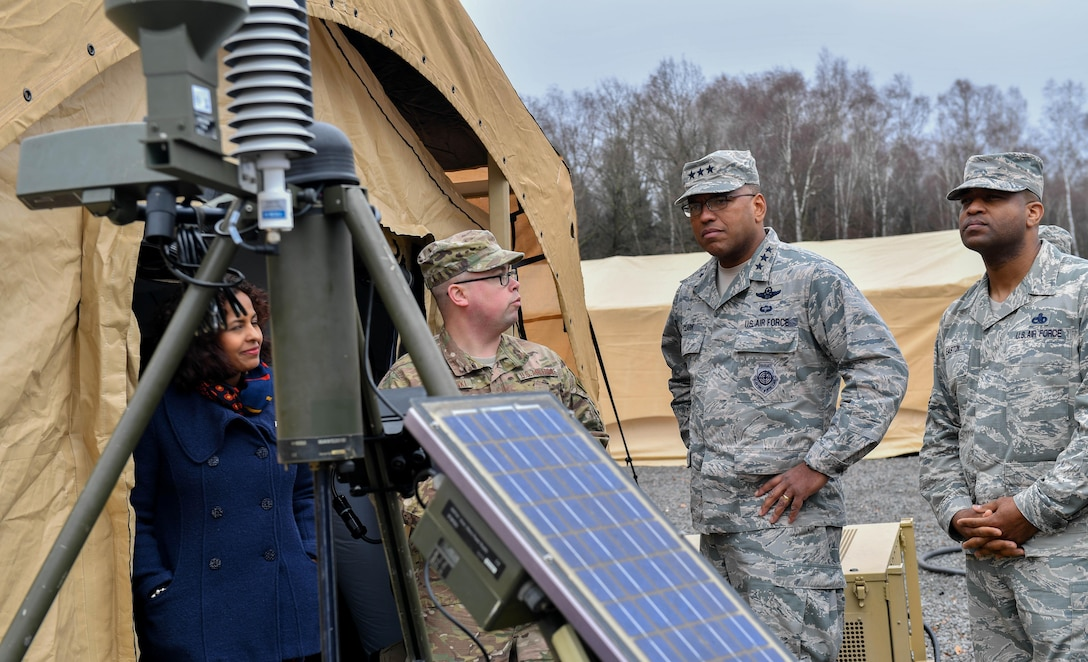 Master Sgt. Joshua Wisnewski, 7th Weather Squadron NCO in charge of training, briefs Lt. Gen. Richard M. Clark, 3rd Air Force commander, and Chief Master Sgt. Phillip Easton, U.S. Air Forces in Europe and Air Forces Africa command chief, about weather equipment during an immersion tour of the 435th Air Ground Operations Wing at Ramstein Air Base, Germany, Feb. 3, 2017. Clark, Easton, and their spouses toured squadrons within the 4th Air Support Operations Group, 435th Air and Space Communications Group, and 435th Contingency Response Group. (U.S. Air Force photo by Senior Airman Tryphena Mayhugh)