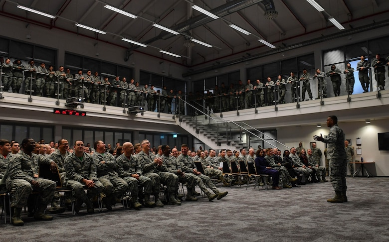 Lt. Gen. Richard M. Clark, 3rd Air Force commander, speaks to Airmen at a commander's call during an immersion tour of the 435th Air Ground Operations Wing at Ramstein Air Base, Germany, Feb. 3, 2017. Clark emphasized the importance of finding a balance between caring for family and completing the mission. (U.S. Air Force photo by Senior Airman Tryphena Mayhugh)