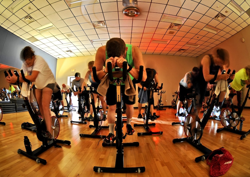 Members of Team Whiteman participate in the E-Cycle Blast Plus class at the fitness center on Whiteman Air Force Base, Mo., Jan. 30, 2017. The class challenges the upper and lower body with resistance, interval and flat ride training to a variety of music. The plus class includes an extra 15 minutes of core work at the end of the class. (U.S. Air Force photo by Tech. Sgt. Miguel Lara III)