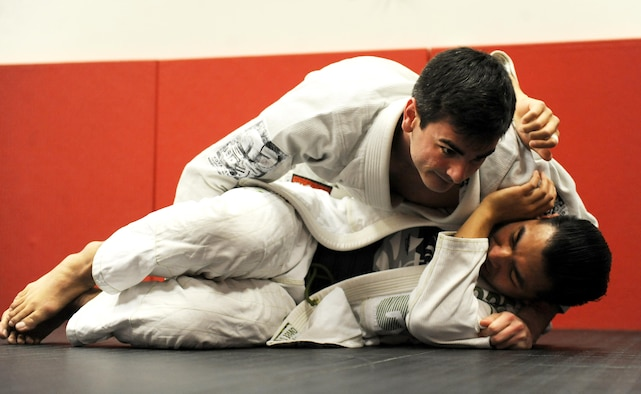 Joshua Joseph, top, takes side control of Patrick Celeste, both students, during the Brazilian Jiu Jitsu class at the fitness center on Whiteman Air Force Base, Mo., Jan. 20, 2017. Students learn the martial art technique of ground fighting during the weekly class offered to adults and youth. (U.S. Air Force photo by Tech. Sgt. Miguel Lara)