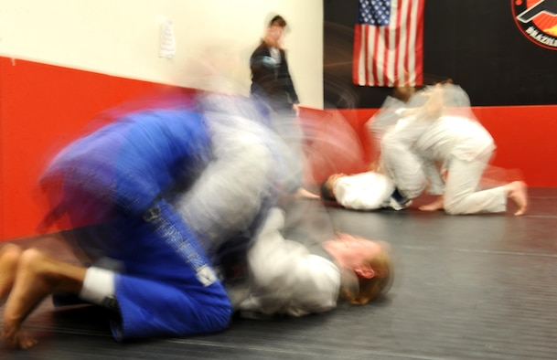 Members of Team Whiteman spar during a Brazilian Jiu Jitsu class at the fitness center on Whiteman Air Force Base, Mo., Jan. 30, 2017. Brazilian Jiu Jitsu, a ground based martial art, teaches practitioners to fight from their backs. Adult and youth classes are offered weekly at the Whiteman fitness center. (U.S. Air Force photo by Tech. Sgt. Miguel Lara)