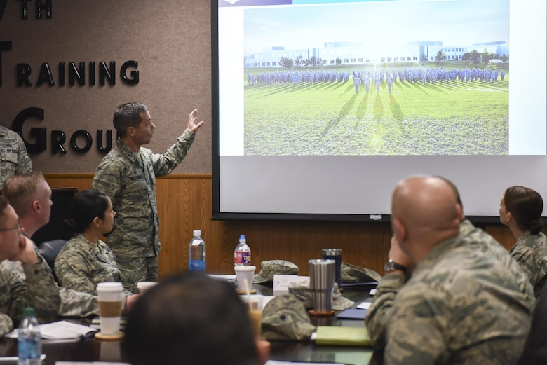 U.S. Air Force Col. Mark Mitchem, 480th Intelligence, Surveillance and Reconnaissance Group Commander, briefs Goodfellow members about the 480th ISR Group at the Brandenburg Hall on Goodfellow Air Force Base, Texas, Feb. 9, 2017. The 480th Intelligence, Surveillance and Reconnaissance Group is located at Fort Gordon in Georgia. (U.S. Air Force photo by Airman 1st Class Chase Sousa/Released)