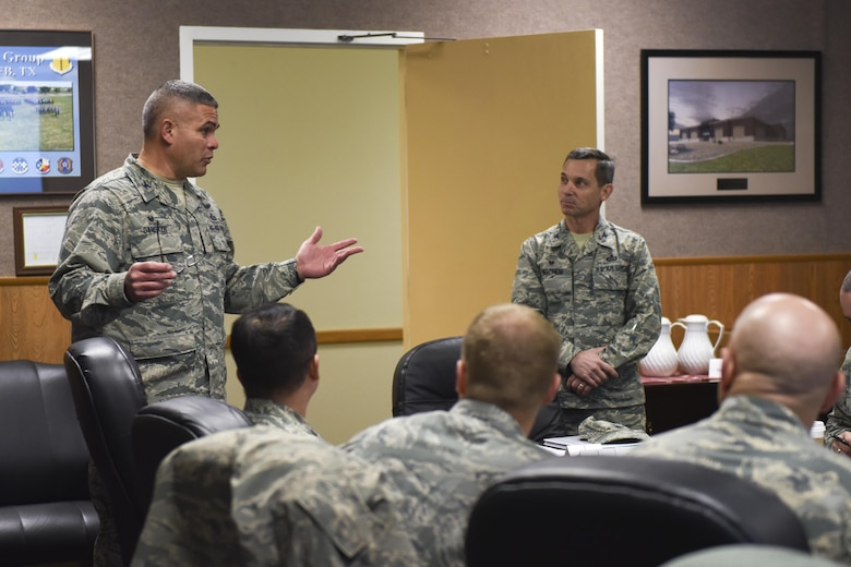 U.S. Air Force Col. Alejandro Ganster, 17th Training Group Commander, introduces Col. Mark Mitchem, 480th Intelligence, Surveillance and Reconnaissance Group Commander, at the Brandenburg Hall on Goodfellow Air Force Base, Texas, Feb. 9, 2017. Mitchem visited as part of an effort to line up resiliency training for first-term Airmen. (U.S. Air Force photo by Airman 1st Class Chase Sousa/Released)