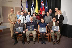 2016 Naval Sea Systems Command Warfare Center Awards were presented on Feb. 2 at NUWC Division Newport. Awards were presented by Rear Adm. Moises DelToro III (far left), commander, NUWC, Mary Wohlgemuth (far right), SES, technical director, NUWC Newport; and Capt. Geoffrey deBeauclair (back row, second from right), commanding officer, NUWC Newport.