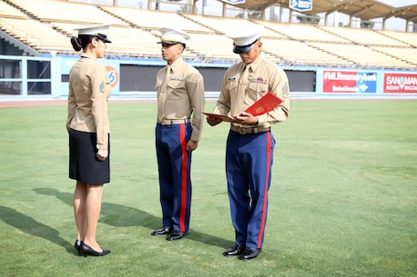 SSgt Jasmin Duran is re-enlisted at Dodger Stadium Nov. 16. Duran decided to conduct her re-enlistment at the stadium because it is her favorite Baseball Team.