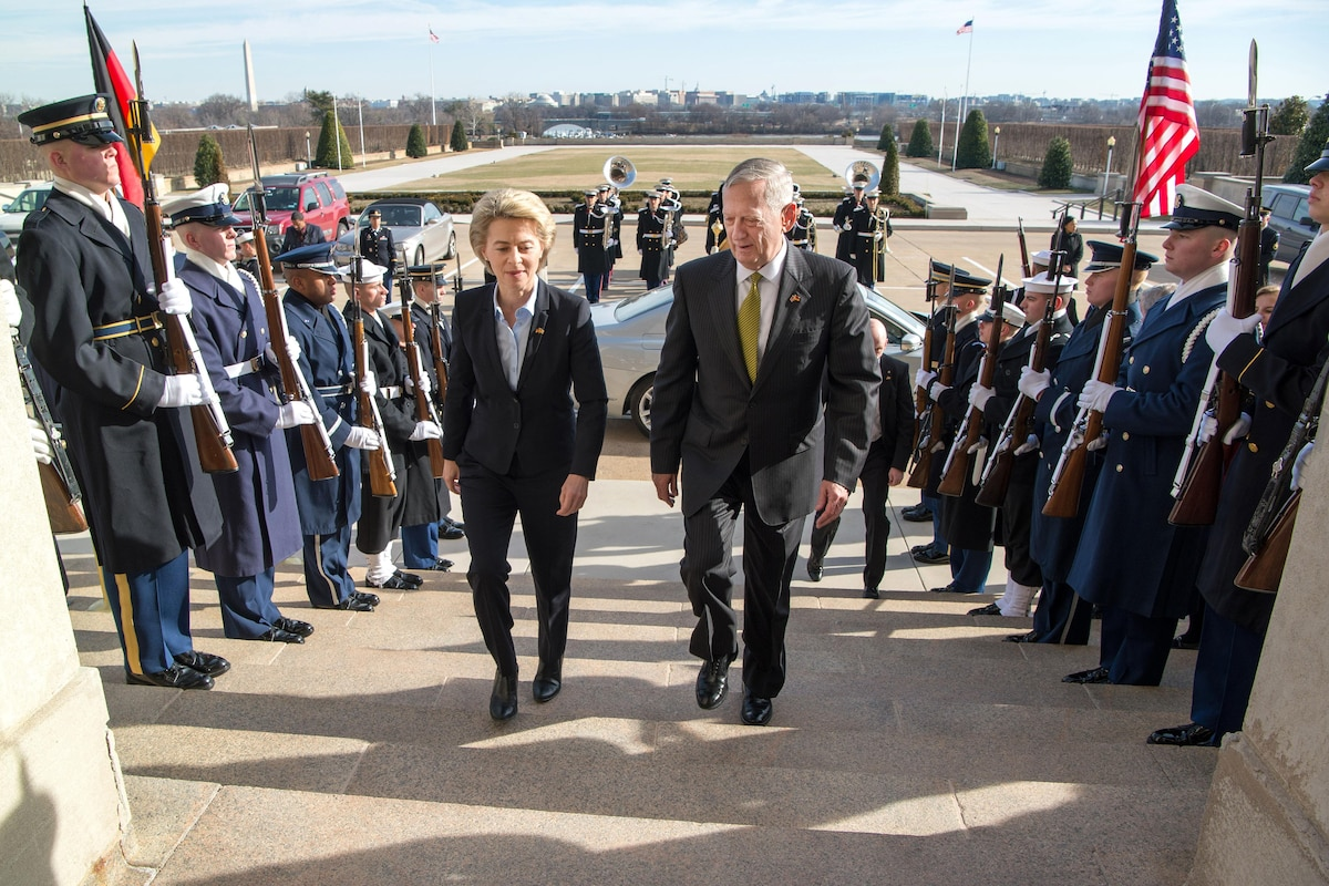 Defense Secretary James N. Mattis walks up steps with the German defense minister.