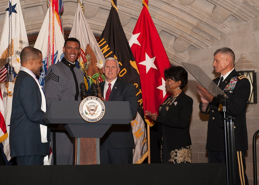 West Point Cadet Christian Nattiel, the U.S. Military Academy's first African American Rhodes Scholar, and retired Army Major Pat Locke, the first female African American USMA graduate, present a bust to Vice President Mike Pence during the Lieutenant Henry O. Flipper Dinner at the academy in West Point, N.Y., Feb. 9, 2017. The dinner is held annually to commemorate the life of Flipper, West Point's first African-American graduate. Army photo by Carmine Cocchia