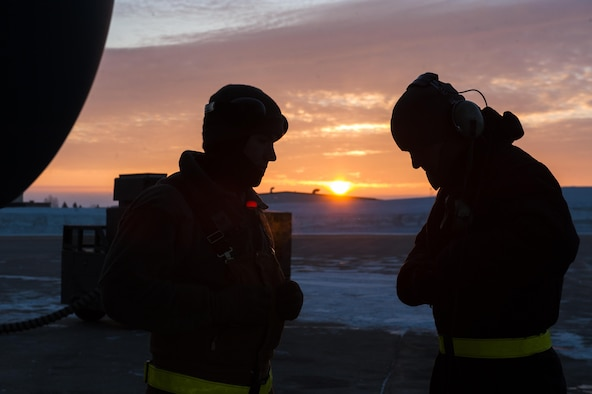 (From left) Senior Airman Daniel Hancock and Senior Airman Josh Serafin, 5th Aircraft Maintenance Squadron crew chiefs, try to stay warm before launching an aircraft at Minot Air Force Base, N.D., Jan 26, 2017. Crew chiefs arrive to the aircraft before the aircrew to perform pre-flight inspections to ensure a safe launch. (U.S. Air Force photo/Senior Airman J.T. Armstrong)