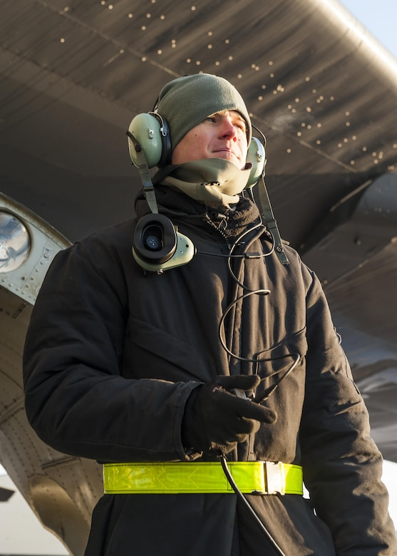 Senior Airman Josh Serafin, 5th Aircraft Maintenance Squadron crew chief, communicates with the aircrew aboard a B-52H Stratofortress prior to launch at Minot Air Force Base, N.D., Jan. 26, 2017. Communication between the aircrew aboard the aircraft and the maintainers outside, is critical to safely launching a B-52. (U.S. Air Force photo/Senior Airman J.T. Armstrong)