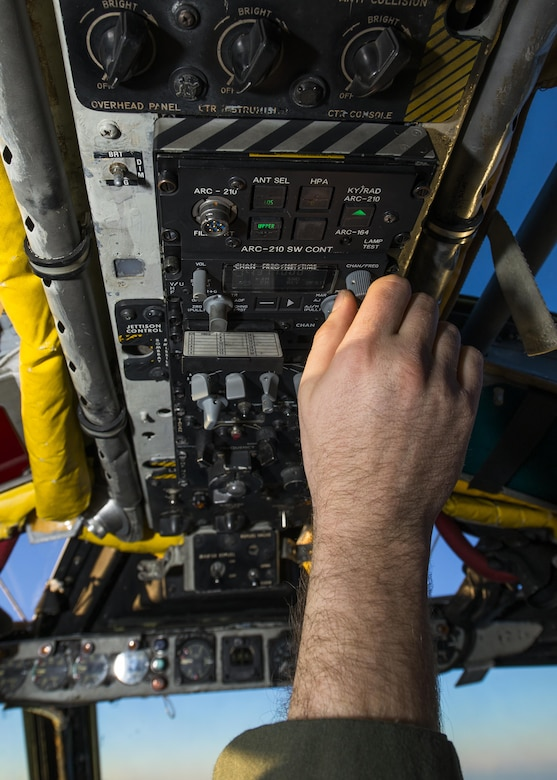 Capt. Dane Weathers, 23rd Bomb Squadron aircraft commander, changes radio frequency inside a B-52H Stratofortress above the clouds in North Dakota airspace, Jan. 31, 2017. Weathers and Capt. Jonathan Gabriel, 23rd BS aircraft commander, worked with their offensive and defensive team to successfully complete a training mission in preparation to support Operation Inherent Resolve. (U.S. Air Force photo/Senior Airman J.T. Armstrong)