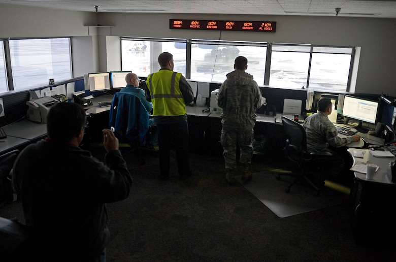 Members of the 62nd Aerial Port Squadron Air Terminal Operations Center, monitor activity on the flightline Feb. 8, 2017 at Joint Base Lewis-McChord, Wash. ATOC coordinates all outside requests for agency support and information and distributes them to the different sections throughout the aerial port for proper coordination. (U.S. Air Force photo/Senior Airman Divine Cox)