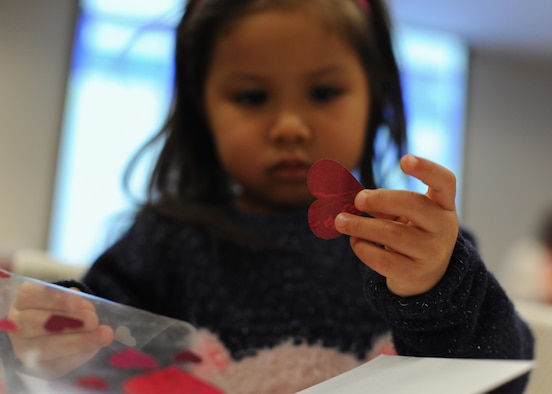 Lilyana Rodriguez, a 5-year-old, decides how to decorate a card for her family Feb. 4, 2017, during the Exceptional Family Member Program's Valentine's Day event, at the Airman & Family Readiness Center on Little Rock Air Force Base, Ark. The event was open to children and families enrolled in the EFMP for an afternoon of dancing and crafting. (U.S. Air Force photo by Airman 1st Class Grace Nichols)