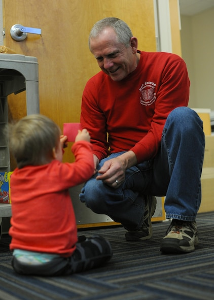 Steve Jones, Exceptional Family Member Program manager, explains shapes to 2-year-old Blake Boccher Feb. 4, 2017, during the EFMP's Valentine's Day event, at the Airman & Family Readiness Center on Little Rock Air Force Base, Ark. The EFMP staff organized and facilitated the event for families to attend. (U.S. Air Force photo by Airman 1st Class Grace Nichols)