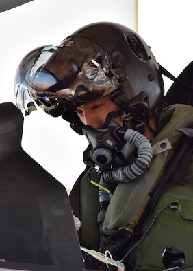 Lt. Col. Nakano, Japan Air Self-Defense Force F-35A national representative pilot to Luke, sits in the cockpit of one of three F-35s on 944th Fighter Wing's ramp area Feb. 7 before departing on his first solo sortie at Luke Air Force Base, Ariz. (U.S. Air Force photo taken by Tech. Sgt. Louis Vega Jr.)