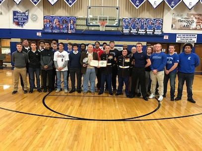 Chillicothe High School head football coach Ron Hinton was awarded the 2017 Semper Fi Coach's award by U.S. Marines with Recruiting Sub-Station Circleville Feb. 7, 2017, during halftime of the Chillicothe Cavaliers boys' varsity basketball game. The Semper Fi Coach Award recognizes a high school football coach who exemplifies the Marine Corps motto: Semper Fidelis – always faithful. It is earned by a coach who models the Marine Corps leadership values of honor, courage, and commitment. Hinton is the only coach to receive the award from Marine Corps Recruiting Station Charleston, which covers much of Tennessee, West Virginia, Virginia, Ohio and Kentucky.  (U.S. Marine Corps photo by Sgt. Caitlin Brink/Released)