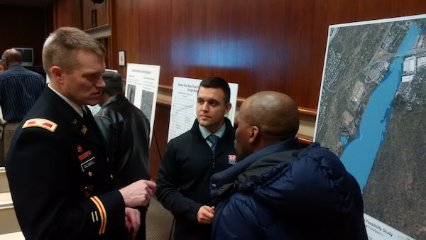 Col. David A. Caldwell, commander, U.S. Army Corps of Engineers, New York District (left), Robert Vohden, real estate specialist, U.S. Army Corps of Engineers, New York District (right), engage in discussions with residents in the study area of the Rahway River Basin Flood Risk Management Study, in Orange, N.J. January 26, 2017.