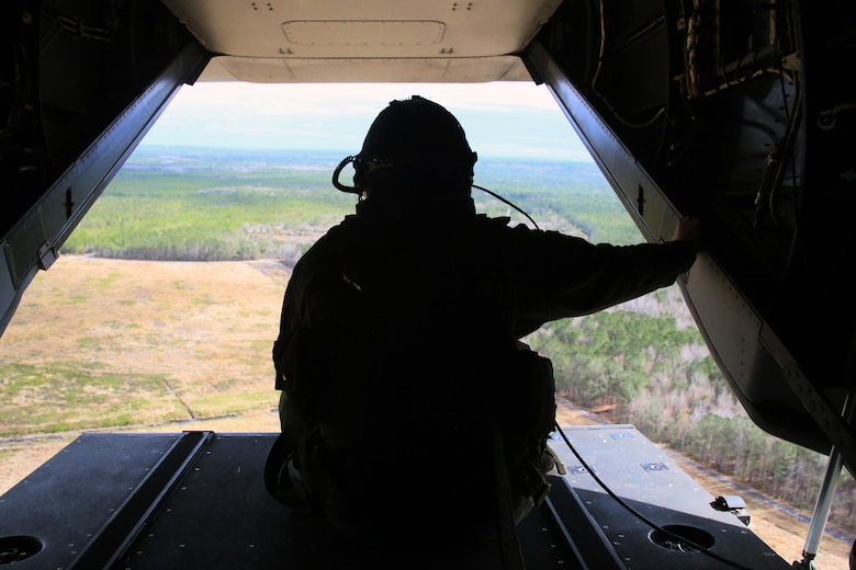 Sgt. Brett Hankins gazes out the back of an MV-22 Osprey as it flies near Marine Corps Air Station New River, N.C., Feb. 9, 2017. Many operations are intensive on Osprey pilots such as aerial refueling, but some flight operations such as external lifts require the pilots to rely on the crew chief. This makes them an essential part to mission accomplishment. Hankins is a crew chief the Marine Medium Tiltrotor Squadron 263, Marine Aircraft Group 26, 2nd Marine Aircraft Wing. (U.S. Marine Corps photo by Cpl. Mackenzie Gibson/Released)