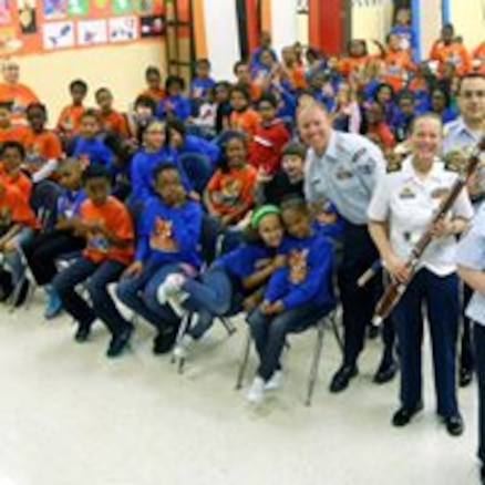 Members of the USAF Langley Winds perform for local  school children in the Hampton, Virginia area.