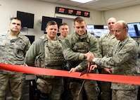 Airmen with the 121st Air Refueling Wing, Ohio Air National Guard join together to celebrate the new base defense operation center February 9, 2017 at Rickenbacker Air National Guard Base, Ohio. (U.S. Air National Guard photo illustration by Senior Airman Ashley Williams)