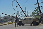 Staff Sgt. Casey Delcambre, a member of the Louisiana Army National Guard's 2nd Battalion, 156th Infantry Regiment, 256th Infantry Brigade Combat Team, directs traffic in New Orleans East, Feb. 10, 2017. The guardsmen are working in support of local, parish and state emergency officials after severe thunderstorms spawned several tornadoes in southeast Louisiana. Louisiana Army National Guard photo by Master Sgt. Toby Valadie